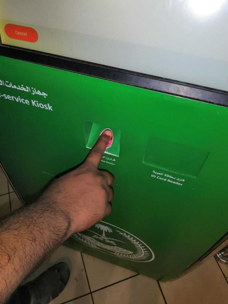right index finger on absher kiosk machine